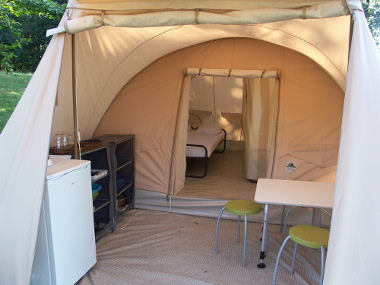 Karsten rental tent with real beds, fridge, cooking and tableware.